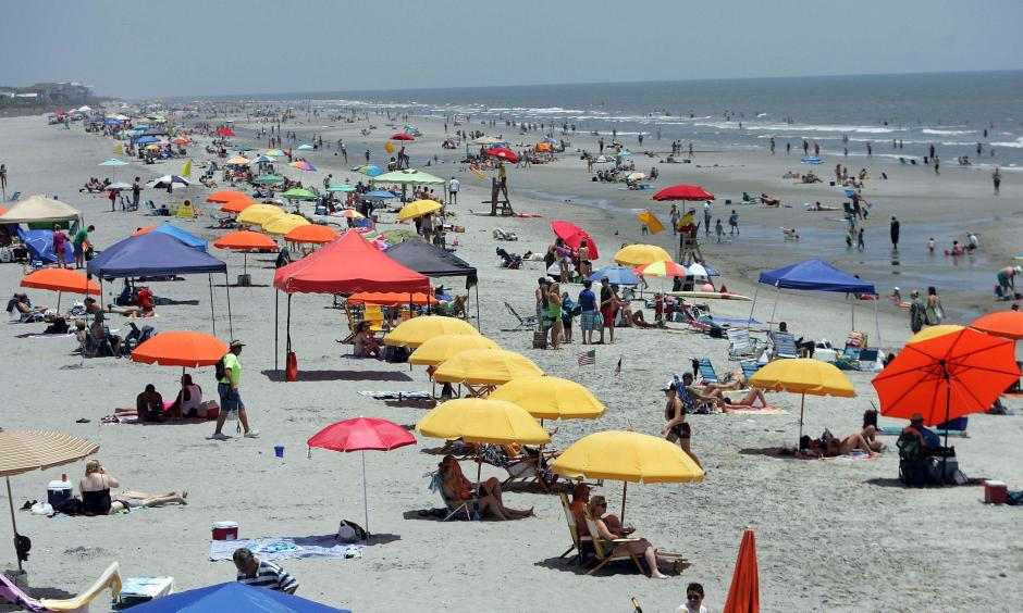 Summer always brings out the beachgoers in the Lowcountry, but a heat wave can create unforeseen dangers. Temperatures should peak Friday and Saturday at or near 100 degrees. But with dangerous heat indices predicted, the American Red Cross is urging caution. Photo: Leroy Burnell
