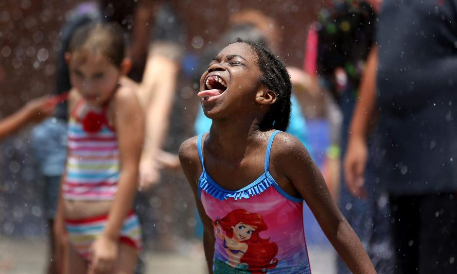 Hundreds of area children enjoyed playing in the water and being sprayed during Big Splash Day at the Joe on July 13. Forecasters say a well-deserved break from the extreme heat and humidity is on the way as we enter August. Photo: Grace Beahm