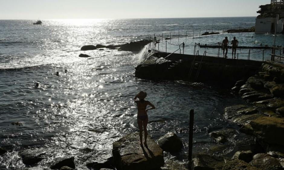 People enjoying the cooler morning conditions at Bronte beach in Sydney's east on Friday morning. Photograph: Dan Himbrechts/AAP