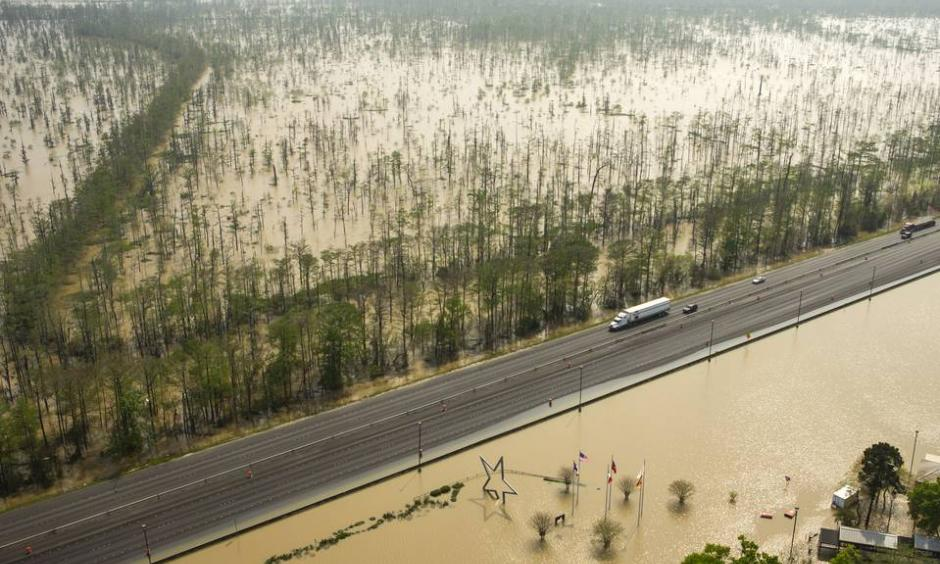 Floodwaters build up around the Texas Travel Information Center, bottom, on Interstate 10 near Orange, Texas. Photo: Brett Coomer, Houston Chronicle/Associated Press
