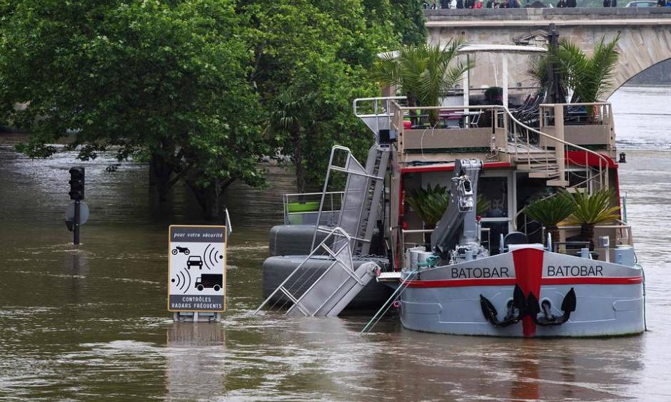 A lounge boat docked in the flooded Seine river in Paris. The rain-swollen river receded significantly on Sunday after reaching its highest level in three decades. Photo: Agence-France-Presse/ Getty Images