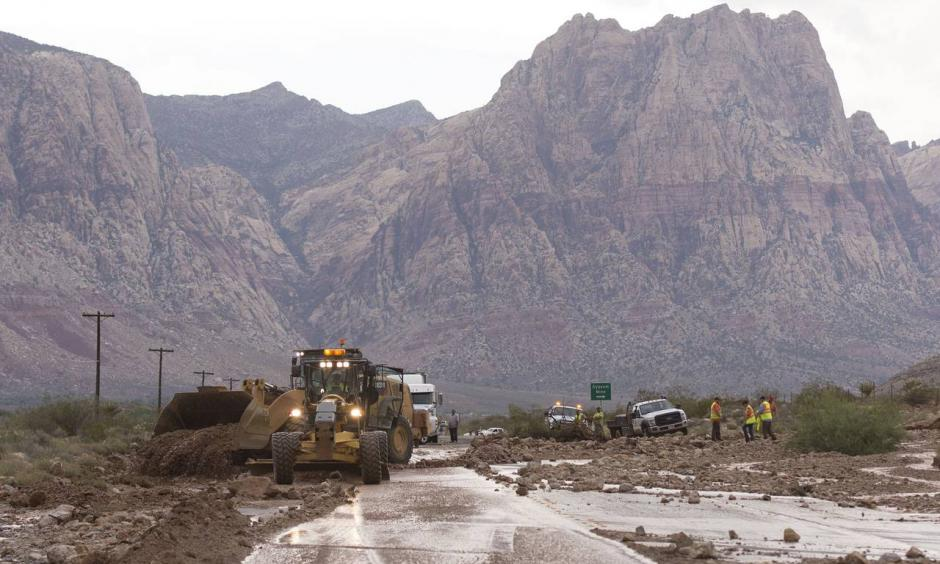 Crews on Highway 159 just south of Bonnie Springs in Red Rock Canyon National Conservation Area near Las Vegas work to reopen the highway, which was closed because of a washout Thursday. Photo: Jason Ogulnik//Las Vegas Review-Journal / AP