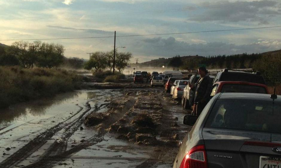 Cars on a road in Lake Hughes, California are stopped because of flooding, with some stuck in the mud in the distance. Flash flooding sent water, mud and rocks rushing across Interstate 5 north of Los Angeles on Thursday, stranding hundreds of vehicles and closing the major north-south thoroughfare. Photo: Robert Rocha , AP