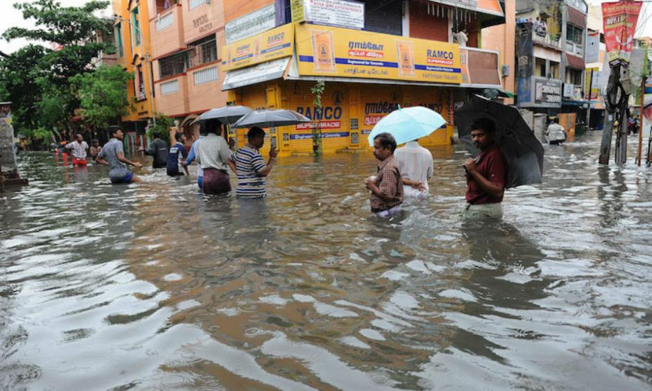 People wade through a flooded street in Chennai, in the southern Indian state of Tamil Nadu, on Wednesday, December 2, 2015. Image credit: AP.