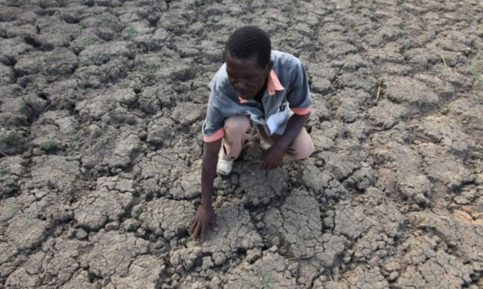 In this photo taken Sunday Jan. 29, 2016, Last Zimaniwa feels the broken ground at a spot which is usually a reliable water source that has dried up due to lack of rains in the village of Chivi , Zimbabwe. Zimbabwean president Robert Mugabe has declared a state of disaster as the country struggles to deal with a drought afflicting the region. Photo: Tsvangirayi Mukwazhi, AP