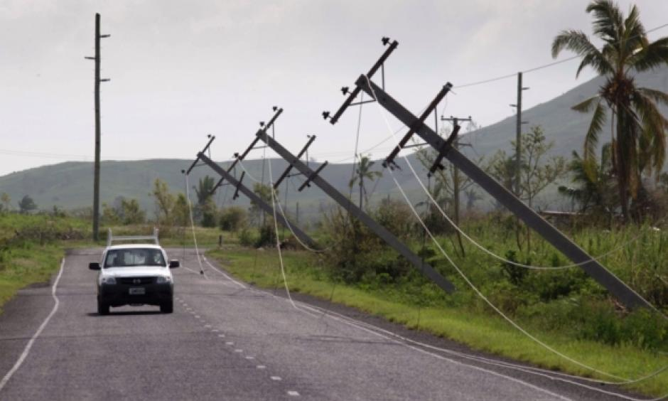 A car drives along Kings Road near Lautoka, Fiji, Wednesday, Feb. 24, 2016, where power poles lean over after cyclone Winston ripped through the island nation. The cyclone tore through Fiji over the weekend with winds that reached 177 miles (285 kilometers) per hour, making it the strongest storm in Fiji's recorded history. Photo: Brett Phibbs, AP