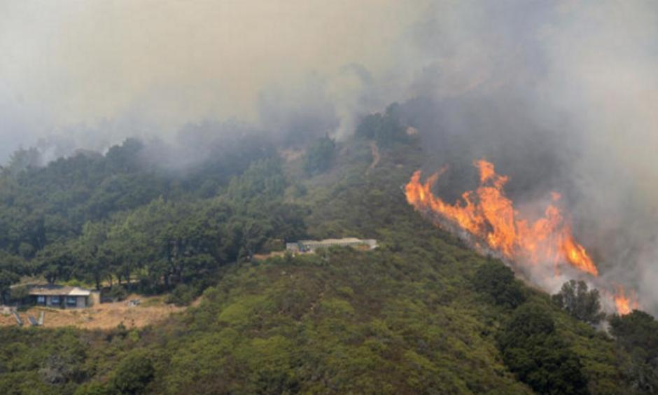 Surfer Don Curry is among those who have lost homes to the raging Soberanes fire. Photo: L.A. Times