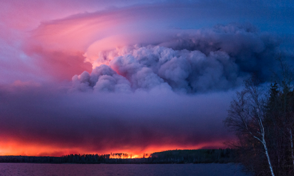 A massive wildfire rages Wednesday evening, May 4, 2016, near Anzac, Alberta, a hamlet 48 km southwest of Fort McMurray. The community and surrounding area was evacuated. A state of emergency exists in the Regional Municipality of Wood Buffalo as a result of wildfires. Photo: Chris Schwarz, Government of Alberta via Creative
