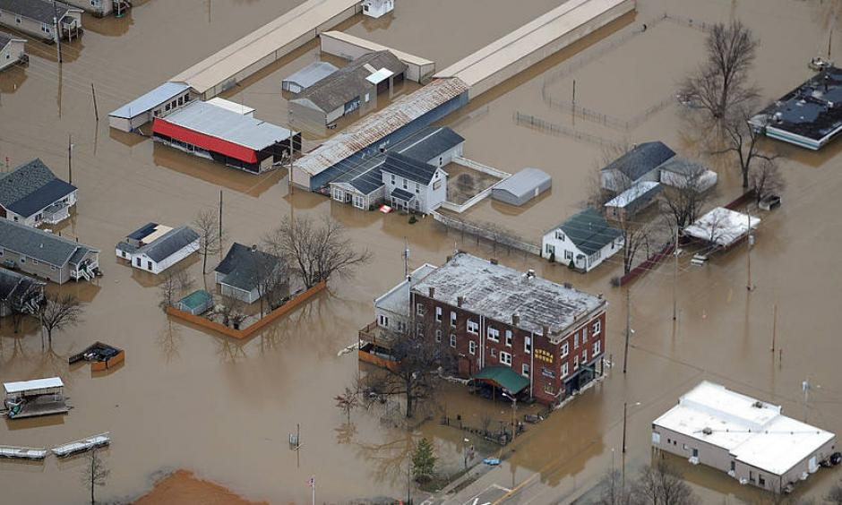 Residents and business are seen submerged in flood water from the Meremac River on December 31, 2015 in downtown Pacific, Missouri. Photo: Michael B. Thomas, Getty Images