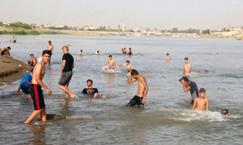Iraqis cool themselves in the Tigris in Baghdad, where temperatures are expected to reach 49C this week. Photograph: Mohammed Jalil/EPA