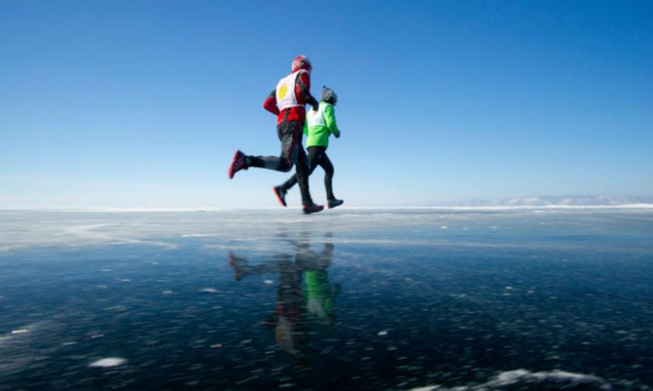 Runners in Siberia, which experienced record heat in 2014. Credit Louise Murray/Robert Harding World Imagery, via Corbis