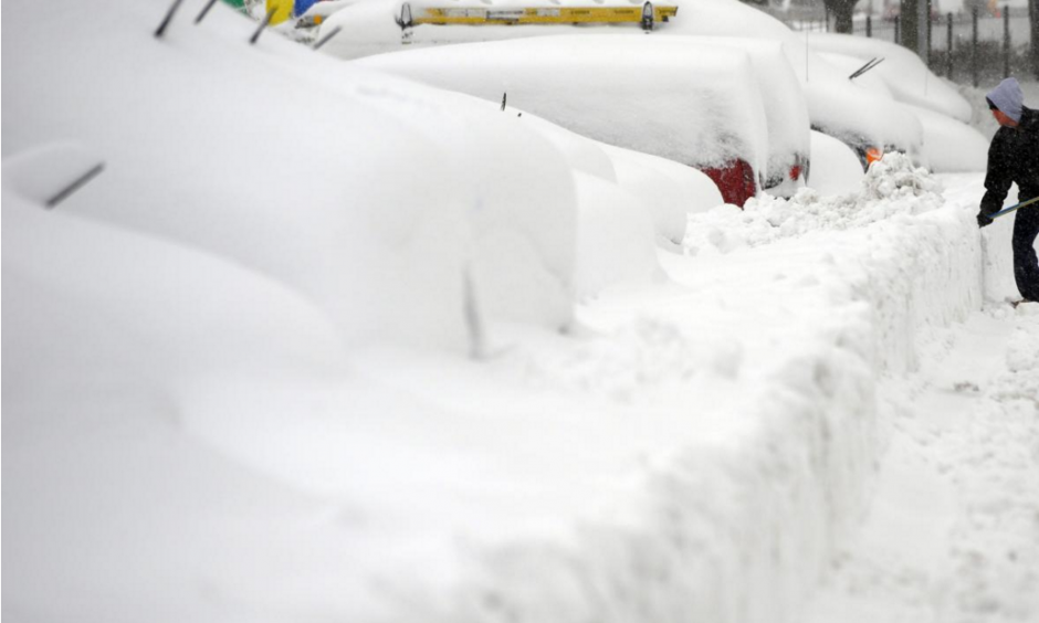 "A man shovels to dig out his car in Silver Spring, Maryland, on Feb. 6, 2010, during the ""Snowmageddon"" snowstorm. This week's blizzard may rival some of the biggest East Coast winter storms in history. Photo: Jewel Samad, AFP, Getty Images"