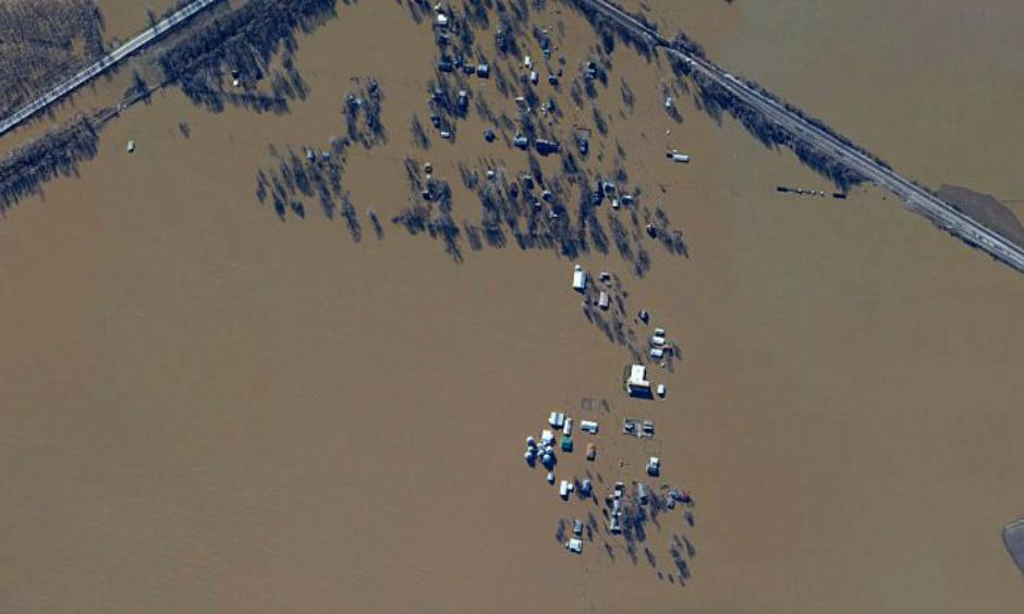 Dozens of houses are seen here underwater in West Alton, Missouri, a town of 522 people. The community lies at the confluence of the Missouri and Mississippi Rivers. (NOAA)