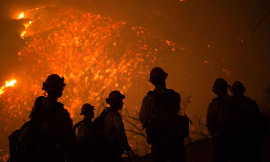 Firefighters battle an expanding wildfire Friday night near Santa Barbara, California. Photo: AFP / Getty