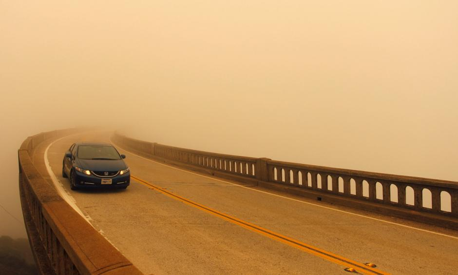 Smoke from the Soberanes Fire reduces visibility over the typically scenic Bixby Bridge on Highway 1 north of Big Sur on Tuesday. Photo: Reuters