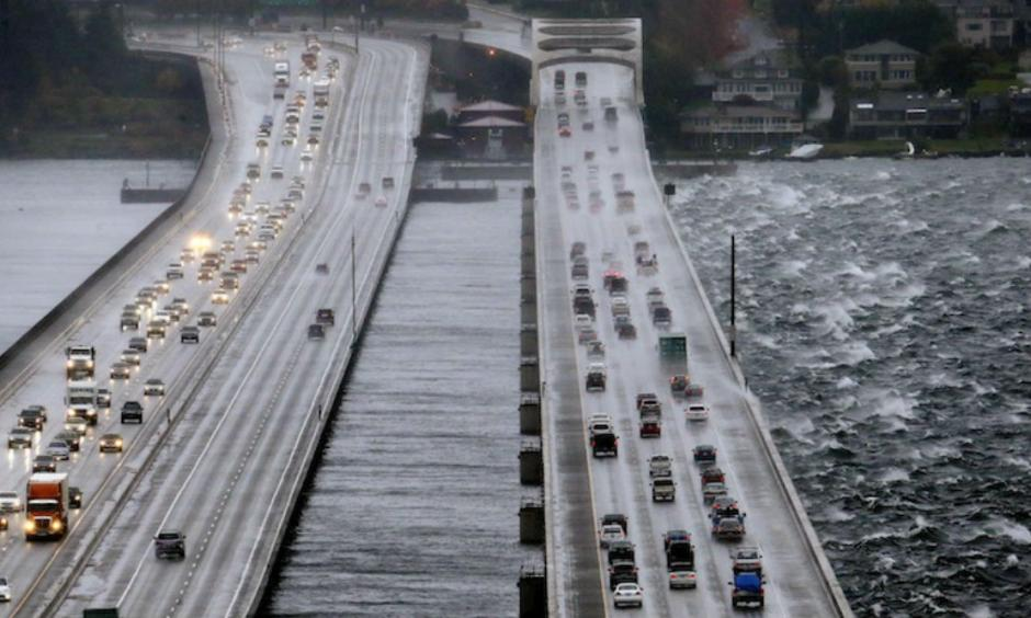 Eastbound traffic lanes, right, on Interstate 90 are dampened by wind-driven waves from the south as the floating bridge calms Lake Washington to the north, left, Tuesday, Nov. 17, 2015, in Seattle. Image credit: AP Photo/Elaine Thompson.