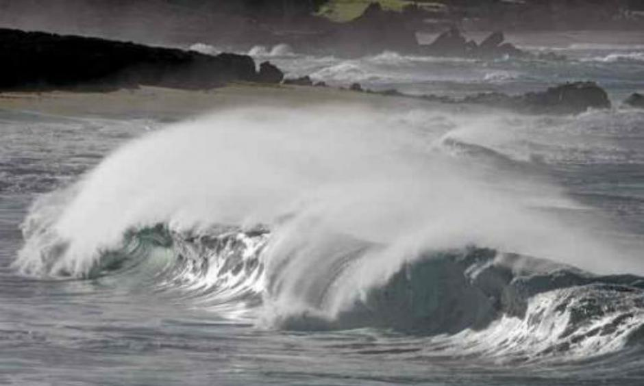 Large waves break at Carmel River State Beach on Friday. (Vern Fisher - Monterey Herald)