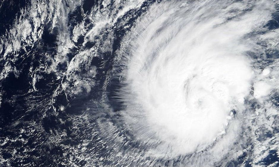 On Jan. 11 at 22:30 UTC (5:30 p.m. EST) the MODIS instrument aboard NASA's Terra satellite captured this visible image of Tropical Storm Pali as it was becoming an early record-breaking hurricane in the Central Pacific Ocean. (Credits: NASA Goddard MODIS Rapid Response)
