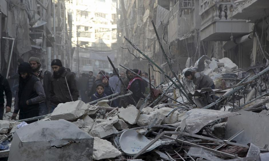Residents inspect damage after airstrikes by pro-Syrian government forces in the rebel held Al-Shaar neighborhood of Aleppo, Syria February 4, 2016. Photo: Abdalrhman Ismail, Reuters