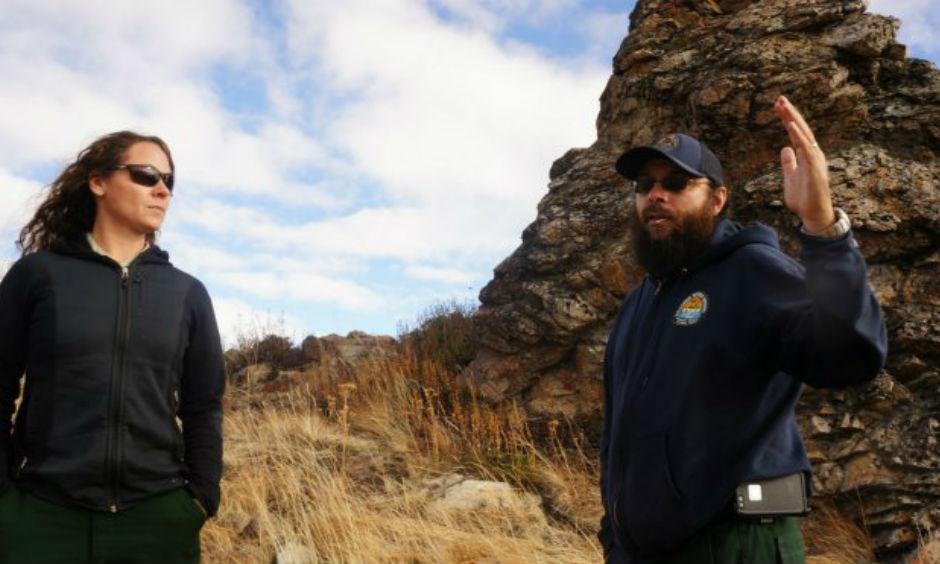 Carly Reed and Jeff Bouschor surveying the burn area.Grist | Ted Alvarez