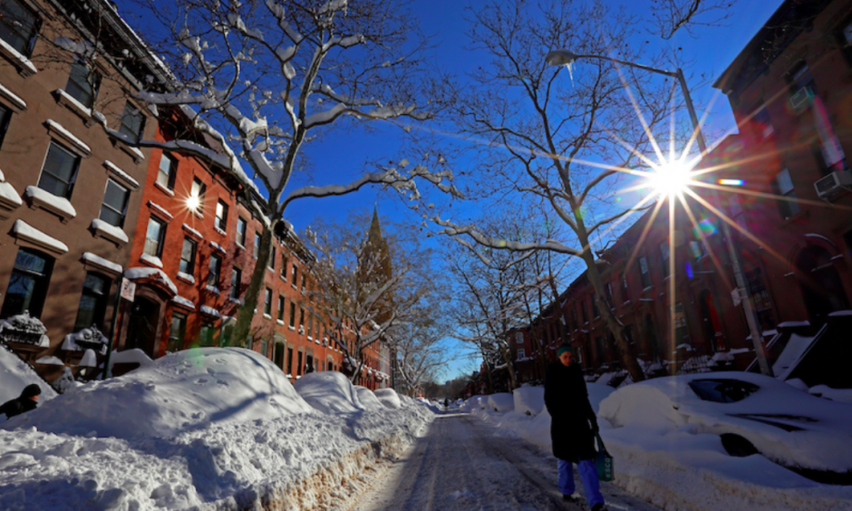 A woman walks down a snow-covered street in Brooklyn on Sunday morning, January 24, 2016. Most of New York City's streets were cleaned up overnight after a huge snow storm slammed into the Mid-Atlantic states. Photo: Michael Heiman, Getty Images