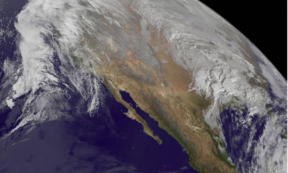Winter storm Jonas gathers itself on Thursday. Near-record sea surface temperatures in the mid-Atlantic – which scientists suggest are driven in part by global warming – are helping to fuel this storm. Phot: NASA/NOAA GOES Project