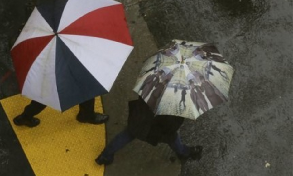 Successive storms bringing rain and snow this weekend could considerably ease California's ongoing fears of drought, according to the National Weather Service. Here, San Francisco pedestrians rely on umbrellas to stay dry. Photo: Jeff Chiu, AP