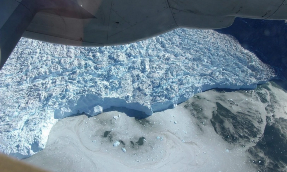 A undated aerial view from an aircraft of the calving front of a glacier in Greenland. Photo: John Sonntag, NASA
