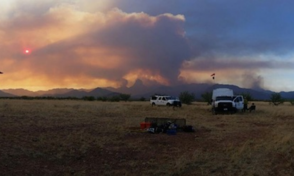 Helicopter-related firefighting efforts were limited on Sunday at the uncontained Brown Fire in far south Arizona, which has affected more than 8000 rugged acres in the Baboquivari Mountains southwest of Tucson. Believed to be caused by humans, the fire is now under investigation. Photo: AZ State Forestry.