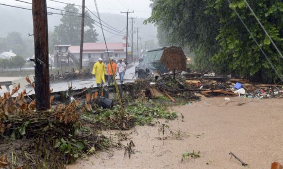 Debris from the Jordan Creek near Clendenin, W.Va., piles up against a culvert along U.S. 119 on June 23, 2016, before the creek's entry into the Elk River. Photo: Chris Dorst, Charleston Gazette, via AP
