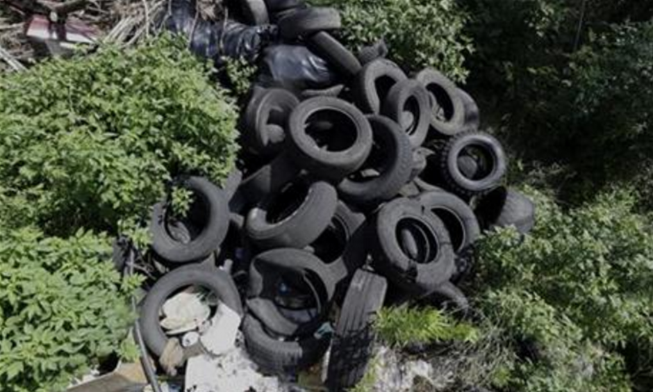 In this photo taken June 22, 2016, a pile of tires sits in a neighborhood near downtown Houston. Trash piles like this are textbook habitat for the mosquitoes that carry Zika, and one example of the challenge facing public health officials. Photo: David J. Phillip, AP