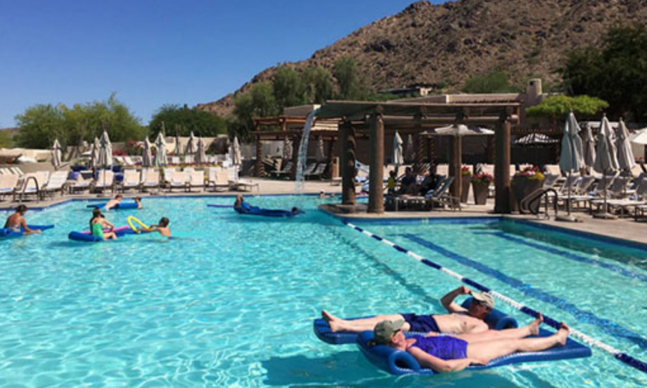 Hotel guests cool off at the pool at the JW Marriott Scottsdale Camelback Inn Resort and Spa in Paradise Valley, Ariz., on Sunday, June 19, 2016. States in the Southwest are in the midst of a summer heat wave as a high pressure ridge bakes Arizona, California and Nevada with extreme, triple-digit temperatures. Photo: Anna Johnson, AP