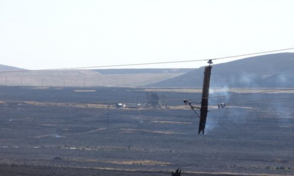A power line near Midas, Nev., sustained damage from the Hot Pot fire that burned perilously close to the Elko County hamlet. Photo shot Monday, July 4, 2016. Photo: Shannon Jackson / Contributed to RGJ