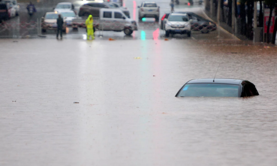 Flooding on the roads in Jiujiang, China. Photo: Feature China / Barcroft Images