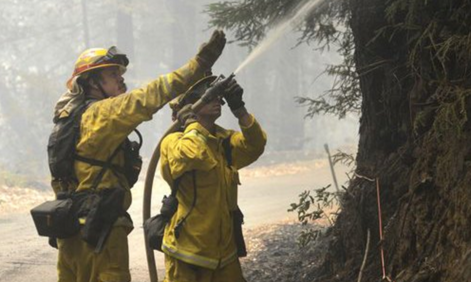 Cal Fire firefighters extinguish hotspots while fighting the Soberanes Fire in Palo Colorado Canyon on the northern Big Sur Coast on Tuesday July 26, 2016 in Big Sur, Calif. Photo: David Royal, AP