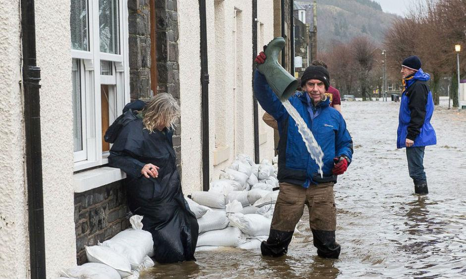 Residents of Tweed Green, Peebles Flooding on Dec. 30, 2015. IMAGE: REX FEATURES/ASSOCIATED PRESS