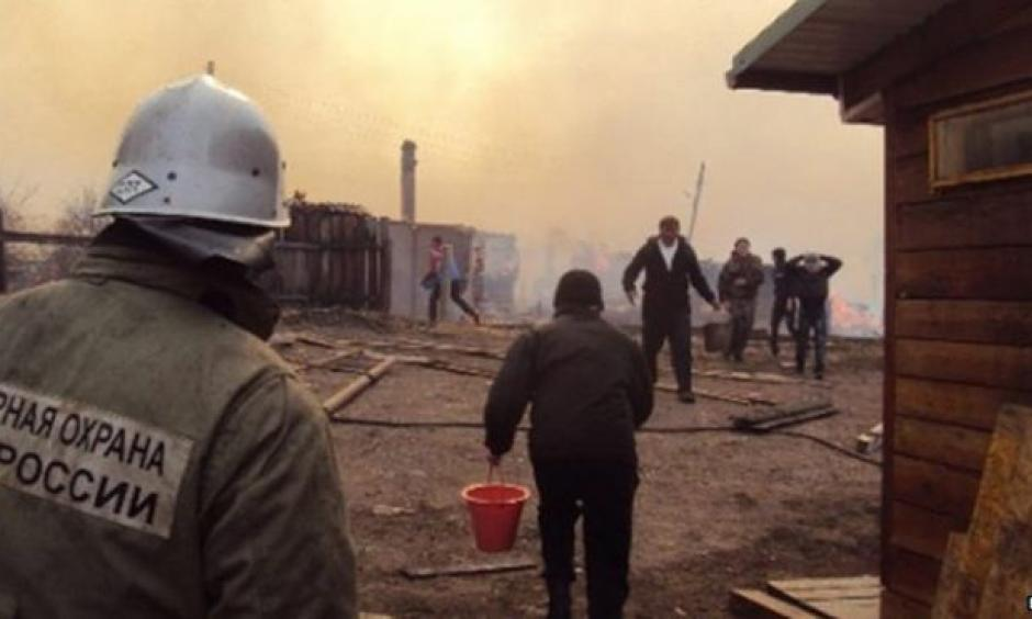 High winds spread the flames quickly across much of the Khakassia region. Image: EPA
