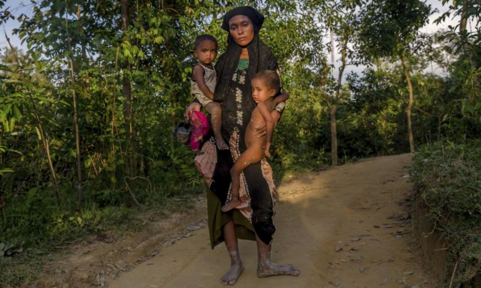 A Rohingya Muslim woman Zahida Banoo holds her son Mohammad Noor, left, and daughter Shah Heer as she poses for a photograph on the way to her shelter in Kutupalong refugee camp, Bangladesh, Friday, Sept. 15, 2017. Those packed into camps and makeshift settlements in Bangladesh are becoming desperate for scant basic resources as hunger and illness soared. Photo: AP