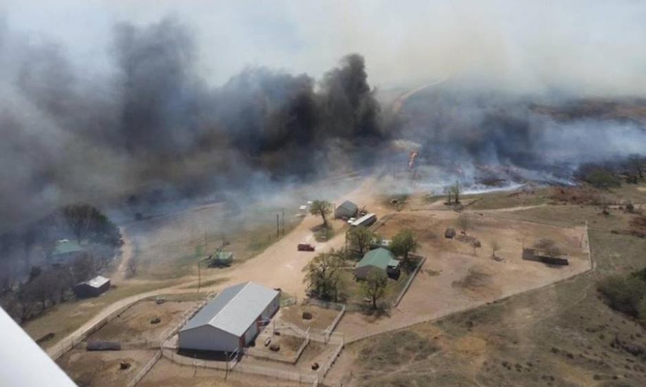 A wildfire rages in Sun City, Kansas, Wednesday after jumping across Highway 160 and crossing over from Oklahoma. Voluntary evacuations were made due to the threat of the fire. Photo: Deb Farris, KAKE News)