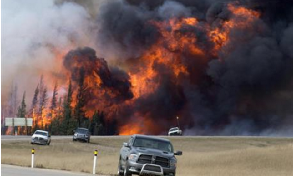 In this May 7, 2016 file photo, a wildfire burns south of Fort McMurray, Alberta. A dry and blistering hot northern Alberta is burning and doing so unusually early in the year, but that's only the latest of many gargantuan fires on an Earth that's grown hotter with more extreme weather. Photo: Jonathan Hayward, The Canadian Press, AP