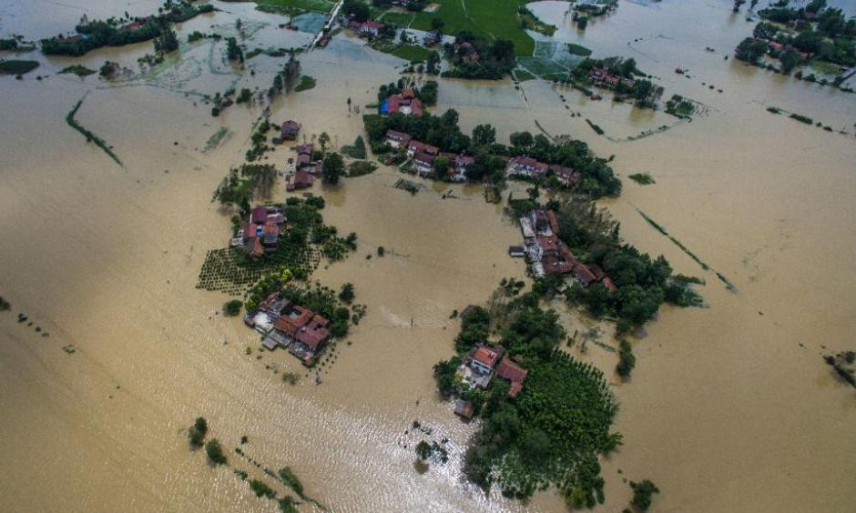 Village houses and field partially submerged by floodwaters in Gaoyang Town, Shayang County, central China's Hubei Province. Photo: Xinhua News Agency