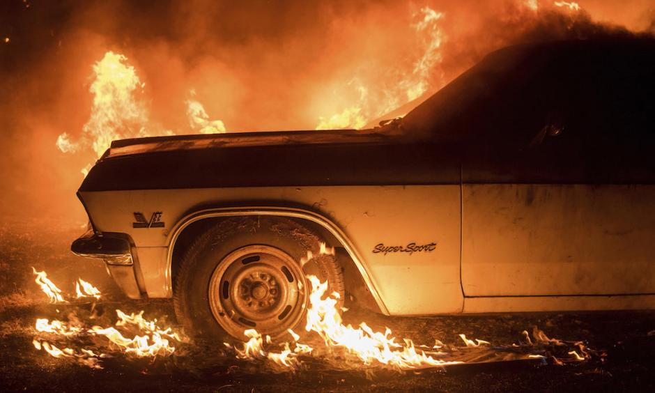 Flames from the Wall Fire consume a vintage Chevrolet Super Sport near Oroville. Photo: NBC Southern California via AP