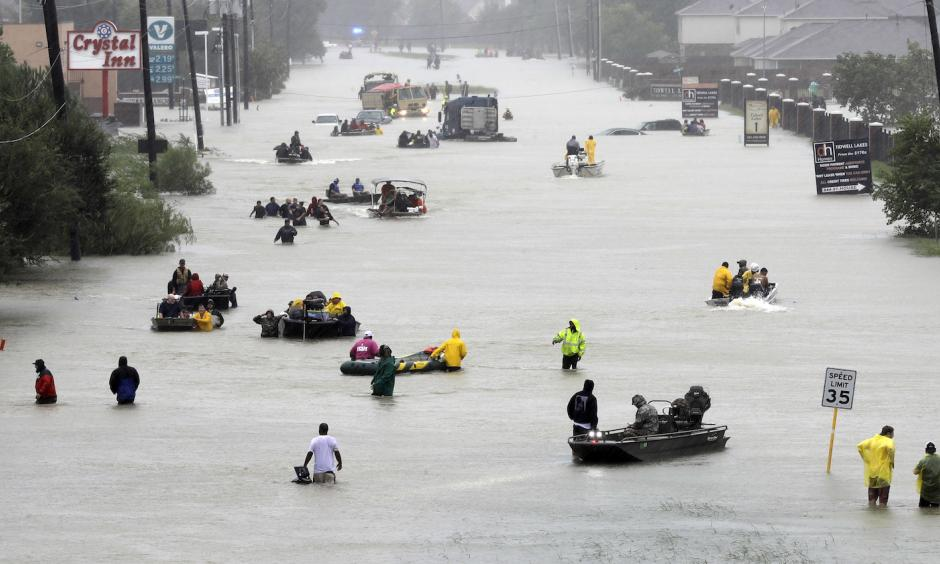 Rescue boats fill a Houston street from flooded from Superstorm Harvey, August 28. Photo: David J. Phillip AP