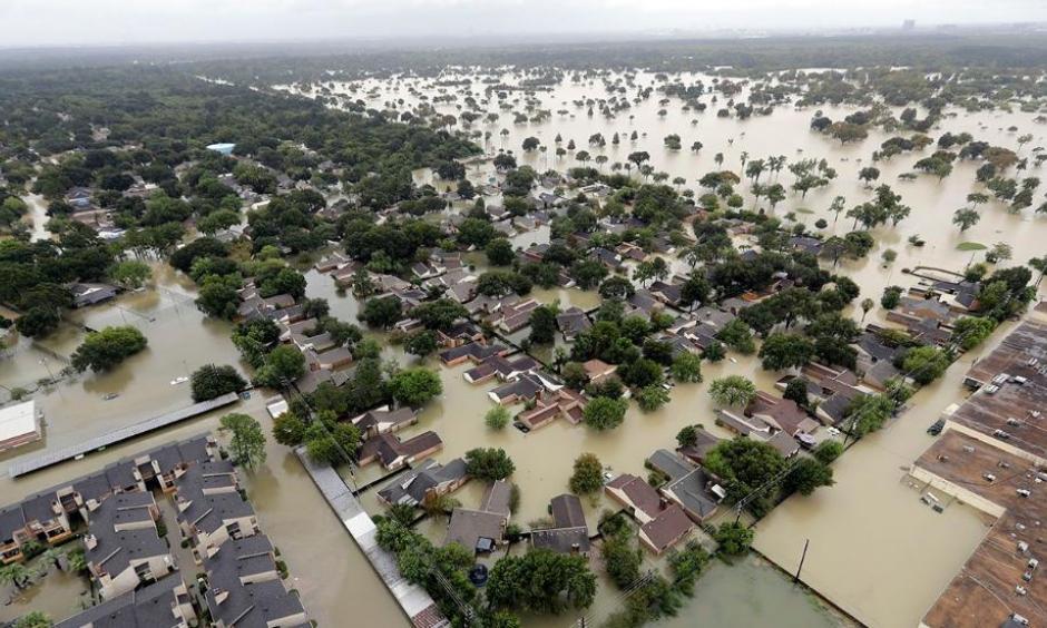 A neighborhood near Addicks Reservoir is seen flooded by rain from Harvey, Tuesday, Aug. 29, 2017, in Houston. Photo: David J. Phillip