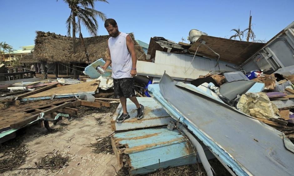 Eric Ward, the bartender at Key Largo's Snappers, inspects the damage from Hurricane Irma at the popular restaurant on Tuesday, Sept. 12, 2017, in Key Largo, Fla. Florida is cleaning up and embarking on rebuilding from Hurricane Irma, one of the most destructive hurricanes in its history. Photo: Al Diaz, Miami Herald via AP