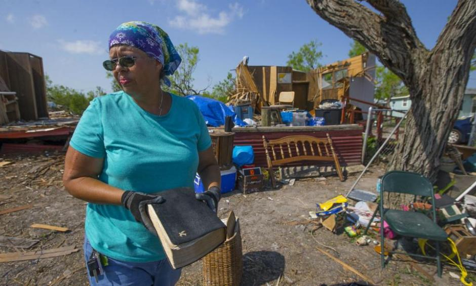 In this Thursday, Sept. 14, 2017, photo, Barbara De Luna holds a bible she recovered from her destroyed home in Bayside, Texas. Bayside took a direct hit from Hurricane Harvey on Aug. 25. Photo: Mark Mulligan, Houston Chronicle via AP