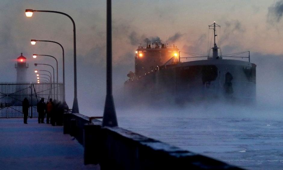 Steam rises from Lake Superior as the ship St. Clair comes to harbor on Sunday, Dec. 31, 2017, at Canal Park in Duluth, Minn. The ship arrived during the coldest holiday week (Dec. 25-31) ever recorded in Duluth. The average temperature for the seven-day period, including both highs and lows, was a bone-chilling –12.1°F. Photo: David Joles, Star Tribune via AP