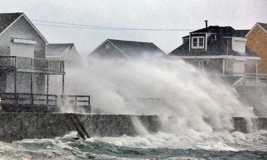 Blizzard conditions slammed snow and spray into the coast of Scituate, Mass., south of Boston, on Thursday, Jan. 4, 2018. Photo: Greg Derr /The Quincy Patriot Ledger via AP