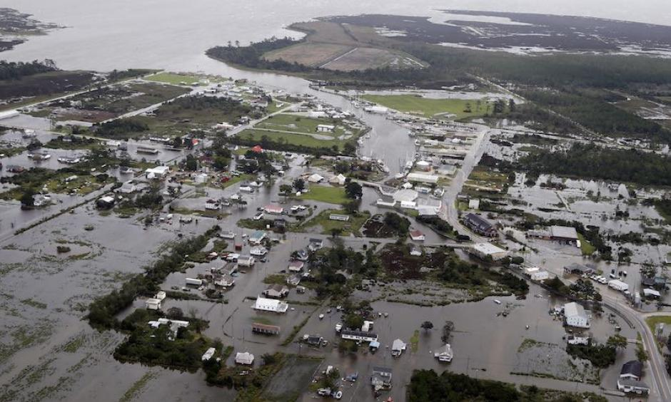 Flooding and storm surge related to Hurricane Florence inundate the town of Engelhard, N.C., on Saturday, Sept. 15, 2018. Engelhard is one of many communities on the west side of Pamlico Sound affected by some of the largest storm surge associated with Florence's slow-motion approach. Credit: AP Photo, Steve Helber
