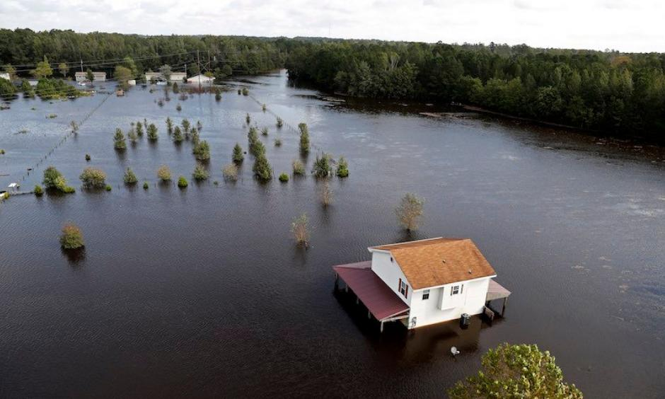 A house is surrounded by floodwaters from Hurricane Florence in Lumberton, N.C., Monday, Sept. 17, 2018. Credit: Gerald Herbert, AP